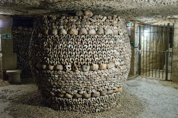 Catacombs eerie pillar decorated by skull and bones