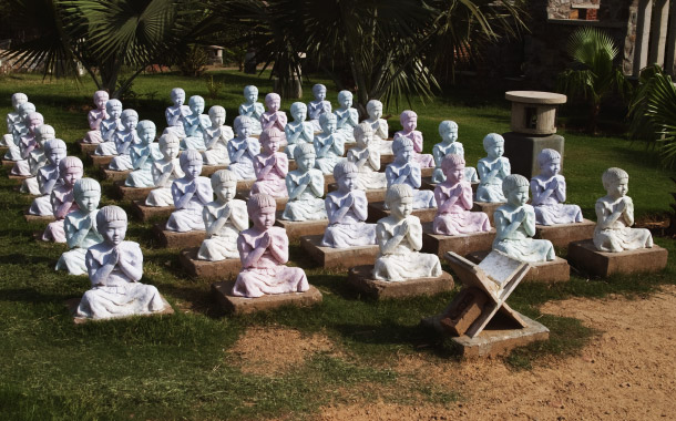 Statues of students studying, Garden of Five Senses